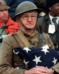 Joseph Ambrose, an 86-year-old World War I veteran, attends the dedication day parade for the Vietnam Veterans Memorial.  He is holding the flag that covered the casket of his son, who was killed in the Korean War. Photo originally from en.wikipedia.